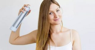 Woman-Sprays-Dry-Shampoo-Into-Her-Hair